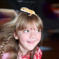 Gecko on girl's head